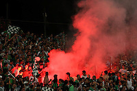 Macabi Haifa fans burn flares during the final of the Israeli cup against Macabi Haifa, 2008 - 9, at the National Stadium of Ramat Gan. Beitar won the cup in a 3 - 0 result. Macabi Haifa won the league 2008 - 9. Photo by Quique Kierszenbaum