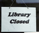 Sign saying 'Library Closed' symbolising closure of libraries as a result of austerity government funding cuts, UK