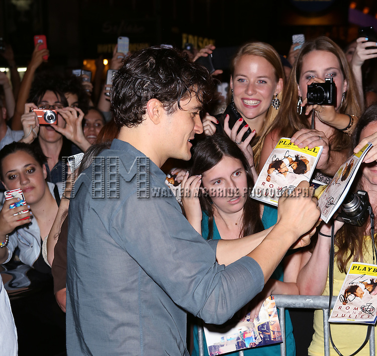 """Orlando Bloom greeting fans at the stage door after the First Performance of """"Romeo And Juliet"""" On Broadway at the Richard Rodgers Theatre in New York City on 8/24/2013"""