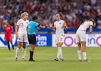 LYON,  - JULY 2: Edina Alves Batista talks to Lucy Bronze #2 during a game between England and USWNT at Stade de Lyon on July 2, 2019 in Lyon, France.