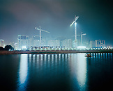CHINA, Macau, Asia, Construction of Wynn Macau hotel with sea in foreground at night
