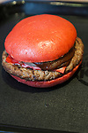 Burger King's red burger ''AKA SAMURAI BEEF'' went on sale on July 3, 2015, in Tokyo, Japan. The two new burgers ''AKA SAMURAI CHICKEN'' and ''AKA SAMURAI BEEF'' use red buns and red cheese, colored by tomato powder and spicy red sauce and will be sold at Japanese branches until August. The AKA SAMURAI CHICKEN costs 540 JPY (4.39 USD) and the AKA SAMURAI BEEF costs at 690 JPY (5.61 USD). As a part of the promotion Burger King plans to launch two new black burgers on August 21st. (Photo by Rodrigo Reyes Marin/AFLO)