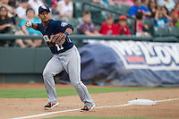 New Orleans Zephyrs third baseman Donovan Solano (17) prepares to make a throw to first base during the Pacific Coast League baseball game against the Round Rock Express on June 30, 2013 at the Dell Diamond in Round Rock, Texas. Round Rock defeated New Orleans 5-1. (Andrew Woolley/Four Seam Images)