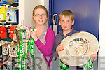 TRIBBLE CROWN: Fiona and Niall Durkin of Castleisland with the Grand Slam and Treble Crown trophies at O2 shop in the Square, Tralee on Sunday.