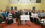 John English, Sec and Geraldine Doggett with the Tredagh Singers Presenting a cheque to Rowan Collins for the Fr. Declan Collins Trust...Photo NEWSFILE/Jenny Matthews.(Photo credit should read Jenny Matthews/NEWSFILE)....This Picture has been sent you under the condtions enclosed by:.Newsfile Ltd..The Studio,.Millmount Abbey,.Drogheda,.Co Meath..Ireland..Tel: +353(0)41-9871240.Fax: +353(0)41-9871260.GSM: +353(0)86-2500958.email: pictures@newsfile.ie.www.newsfile.ie.FTP: 193.120.102.198.