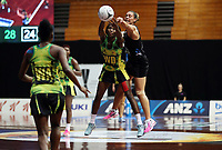 24.02.2018 Silver Ferns Grace Kara and Jamaica's Stacian Facey in action during the Silver Ferns v Jamaica Taini Jamison Trophy netball match at the North Shore Events Centre in Auckland. Mandatory Photo Credit ©Michael Bradley.