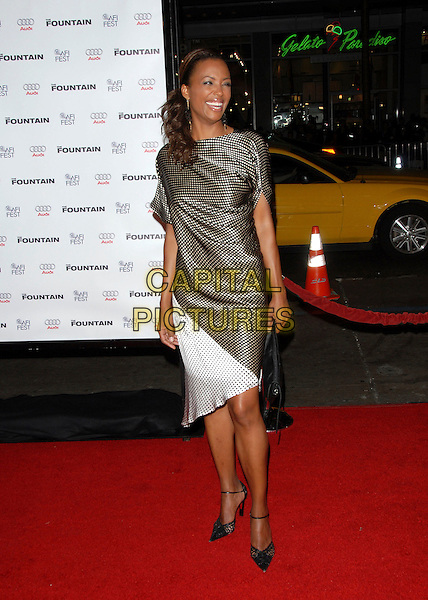 AISHA TYLER.attends AFI Film Festival & Warner Brothers' Screening of The Fountain held at The Grauman's Chinese Theatre in Hollywood, California, USA, November 11th 2006.full length brown white polka dot dress.Ref: DVS.www.capitalpictures.com.sales@capitalpictures.com.©Debbie VanStory/Capital Pictures