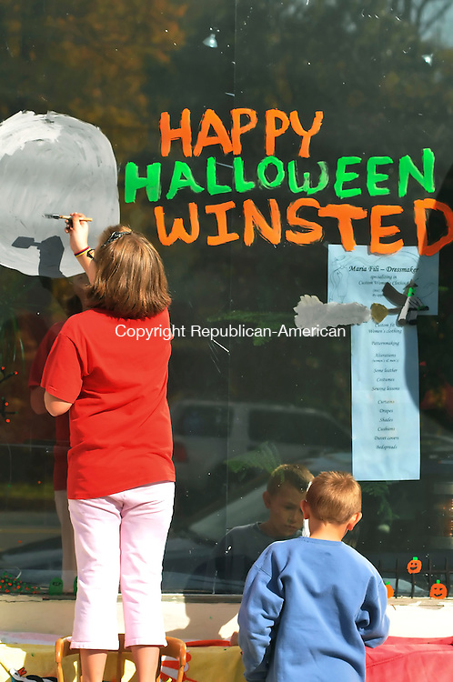 WINSTED, CT-17 OCTOBER 2009-101709JS07- Vanessa Gagnon, 9, left, and Ben Andersen, 9, paint the storefront window of Maria Fili Dressmaker during a Halloween window painting contest in Winsted on Saturday. The event is sponsored by The Friends of Main Street.  <br /> Jim Shannon Republican-American