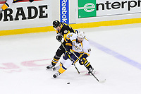 May 29, 2017: Pittsburgh Penguins center Evgeni Malkin (71) battles Nashville Predators left wing James Neal (18) for the puck in the neutral zone during game one of the National Hockey League Stanley Cup Finals between the Nashville Predators  and the Pittsburgh Penguins, held at PPG Paints Arena, in Pittsburgh, PA. Pittsburgh defeats Nashville 5-3 in regulation time.  Eric Canha/CSM