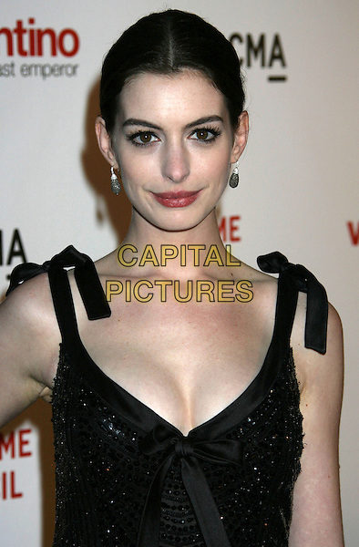 "ANNE HATHAWAY & VALENTINO GARAVANI .""Valentino: The Last Emperor"" Los Angeles Premiere held at LACMA,  Los Angeles, CA, USA, .1st April 2009..portrait headshot black bow sequined beaded bows shoulder straps tied earrings lipstick satin cleavage pale skin .CAP/ADM/MJ.©Michael Jade/Admedia/Capital Pictures"