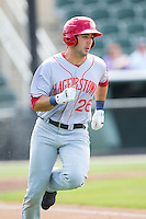 Carlos Lopez (26) of the Hagerstown Suns hustles down the first base line against the Kannapolis Intimidators at CMC-Northeast Stadium on June 1, 2014 in Kannapolis, North Carolina.  The Intimidators defeated the Suns 5-1 in game one of a double-header.  (Brian Westerholt/Four Seam Images)