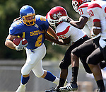 MADISON, SD - AUGUST 30: Andrew Fatten of Dakota State University tries to escape the grasp of Edward James of Bacone College in the first quarter of their game Saturday afternoon at Trojan Field in Madison. (photo by Dave Eggen/Inertia)
