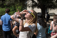 Occidental College students, staff, faculty and neighbors watch a partial eclipse of the sun during the Great American Eclipse on Aug. 21, 2017.<br /> (Photo by Marc Campos, Occidental College Photographer)