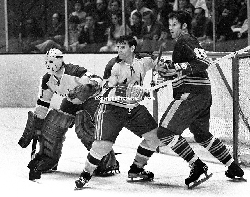 Seal Wayne Muloin blocks Buffalo Sabres #15 Gerry Meehan ...goalie Gary Smithj. (1971 photo/Ron Riesterer)