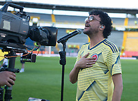 BOGOTA - COLOMBIA, 03-06-2019: Andres Cepeda interpreta el himno de Colombia previo alpartido amistoso entre Colombia y Panamá jugado en el estadio El Campín en Bogotá, Colombia. / Andres Cepeda, colombian singer, performs the national prior a friendly match between Colombia and Panama played at Estadio El Campin in Bogota, Colombia. Photo: VizzorImage/ Gabriel Aponte / Staff