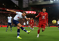27th October 2019; Anfield, Liverpool, Merseyside, England; English Premier League Football, Liverpool versus Tottenham Hotspur; Harry Kane of Tottenham Hotspur makes a clearance under pressure from Roberto Firmino of Liverpool - Strictly Editorial Use Only. No use with unauthorized audio, video, data, fixture lists, club/league logos or 'live' services. Online in-match use limited to 120 images, no video emulation. No use in betting, games or single club/league/player publications