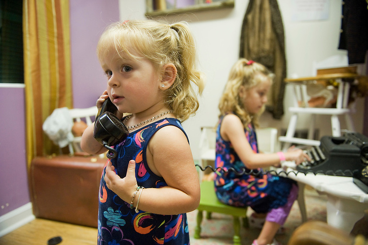 UNITED STATES - JULY 25:  Addie Ferguson, 2, and her cousin Cassie Hoffman, 5, take advantage of an office suite in the Playseum on 8th St., SE.  (Photo By Tom Williams/Roll Call)