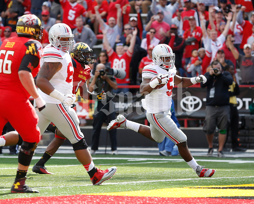 Ohio State Buckeyes linebacker Raekwon McMillan (5) returns an interception for a touchdown during the fourth quarter of the NCAA football game against the Maryland Terrapins at Byrd Stadium in College Park, Maryland on Oct. 4, 2014. (Adam Cairns / The Columbus Dispatch)