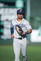 Tri-City Dust Devils right fielder Tre Carter (4) jogs off the field between innings of a Northwest League game against the Everett AquaSox at Everett Memorial Stadium on September 3, 2018 in Everett, Washington. The Everett AquaSox defeated the Tri-City Dust Devils by a score of 8-3. (Zachary Lucy/Four Seam Images)