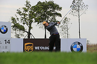 He Ze-yu (CHN) tees off the 14th tee during Sunday's Final Round of the 2014 BMW Masters held at Lake Malaren, Shanghai, China. 2nd November 2014.<br /> Picture: Eoin Clarke www.golffile.ie