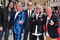 Rick Parfitt, Francis Rossi (second and third from left) and Uriah Heep<br /> The &quot;Bula Quo!&quot; UK film premiere, Odeon West End cinema, Leicester Square, London, England.<br /> July 1st, 2013<br /> half length blue black suit white shirt tinted glasses arms crossed devil hand sign gesture fingers <br /> CAP/BF<br /> &copy;Bob Fidgeon/Capital Pictures