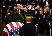 US Vice President Mike Pence (2L) and Second Lady of the United States Karen Pence (L) pay their respects at the casket bearing the remains of former US President George H.W. Bush at the US Capitol during the State Funeral in Washington, DC, December 3, 2018. - The body of the late former President George H.W. Bush travelled from Houston to Washington, where he will lie in state at the US Capitol through Wednesday morning. Bush, who died on November 30, will return to Houston for his funeral on Thursday. (Photo by Brendan SMIALOWSKI / AFP)