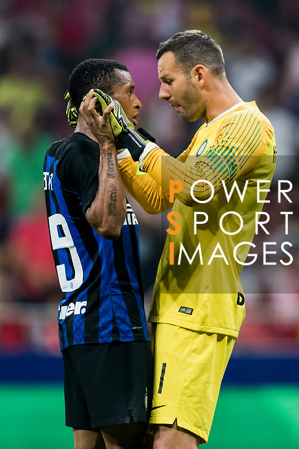 Goalkeeper Samir Handanovic (R) of FC Internazionale speaks to teammate Dalbert Henrique during their International Champions Cup Europe 2018 match between Atletico de Madrid and FC Internazionale at Wanda Metropolitano on 11 August 2018, in Madrid, Spain. Photo by Diego Souto / Power Sport Images