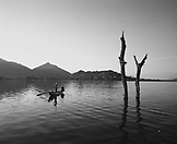 SRI LANKA, Dambulla, Asia, silhouette of fishermen on boat at Kandalama Lake