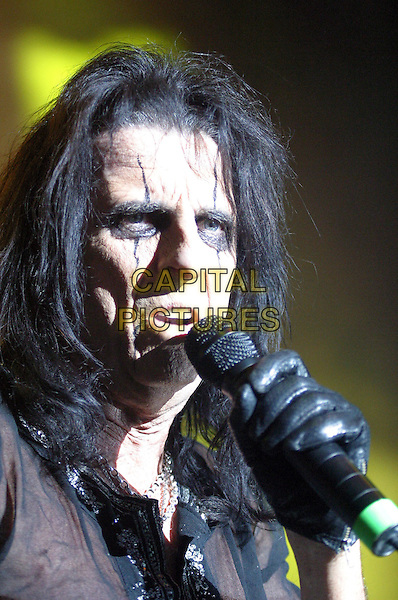 ALICE COOPER.Alice Cooper Live at Nottingham Arena, Nottingham..UK, United Kingdom..16th November 2005.Ref: JEZ.portrait headshot performing concert live music gig on stage singing holding microphone black eye make-up.www.capitalpictures.com.sales@capitalpictures.com.©Capital Pictures