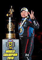 Nov 17, 2019; Pomona, CA, USA; NHRA funny car driver Robert Hight poses for a portrait with the championship trophy after clinching the 2019 funny car world championship during the Auto Club Finals at Auto Club Raceway at Pomona. Mandatory Credit: Mark J. Rebilas-USA TODAY Sports