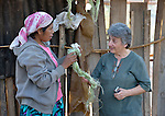 A Wichi indigenous woman, Griselda Arias (left) discusses natural fibers used for creating bags and jewelry with Sister Norma Chiappe, at Arias' home in Lote 75, an indigenous neighborhood of Embarcacion, Argentina. The Wichi in this area, largely traditional hunters and gatherers, have struggled for decades to recover land that has been systematically stolen from them by cattleraisers and large agricultural plantations. Chiappe is a member of the Franciscan Missionaries of Mary who lives in Lote 75.