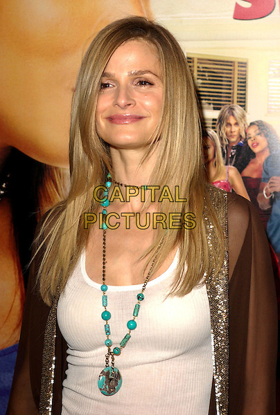 "KYRA SEDGWICK.MGM's World Premiere of ""Beauty Shop"" held at The Mann National Theater in Westwood, California.March 24th, 2005.headshot portrait turquoise necklace.www.capitalpictures.com.sales@capitalpictures.com.Supplied By Capital PIctures"