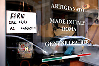 A made in Italy shop closed for holidays in Rome's center<br /> Rome March 10th 2020. Rome the day after the last Minister Council's decree, that extends the restrictions from North of Italy to the entire country to contain Covid-19 Virus. All the shops (restaurants, pubs, and even supermarkets) will have to close at 6 pm. Gathering of people will be forbitten and people will have to maintain the 1 meter security distance. Citizens are furthermore invited to stay at home with the exception of people who have to go to work, to the pharmacy or to the supermarket.<br /> Photo Samantha Zucchi Insidefoto