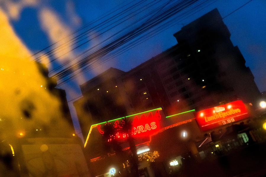 Shining city lights are seen through a rainy car window during the twilight in Quito, Ecuador, 12 November 2012.