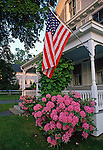 Flag on a porch, Camden, Maine, USA