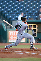 Jacob Gonzalez (18) of the Augusta GreenJackets follows through on his swing against the Greensboro Grasshoppers at First National Bank Field on April 10, 2018 in Greensboro, North Carolina.  The GreenJackets defeated the Grasshoppers 5-0.  (Brian Westerholt/Four Seam Images)