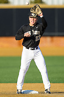 Wake Forest Demon Deacons second baseman Jimmy Redovian (23) fields a throw between innings of the game against the Georgetown Hoyas at Wake Forest Baseball Park on February 16, 2014 in Winston-Salem, North Carolina.  The Demon Deacons defeated the Hoyas 3-2.  (Brian Westerholt/Four Seam Images)