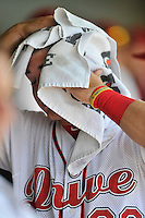 First baseman Mitchell Gunsolus (22) of the Greenville Drive cools off in the dugout during a game against the Lakewood BlueClaws on Sunday, June 26, 2016, at Fluor Field at the West End in Greenville, South Carolina. Greenville won, 2-1. (Tom Priddy/Four Seam Images)
