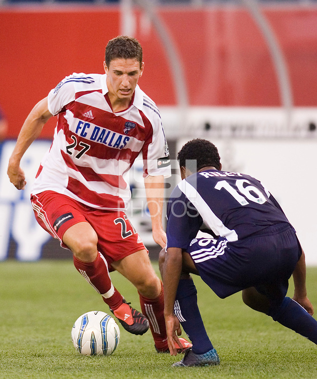 FC Dallas' Aaron Pitchkolan cuts inside on James Riley of the Revolution. The New England Revolution defeated FC Dallas 3 to 2 at Gillette Stadium, Foxbourgh, MA, on July 16, 2005.