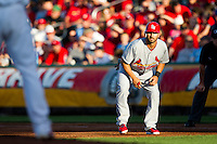 Daniel Descalso (33) of the St. Louis Cardinals takes a lead off first base during a game against the Springfield Cardinals at Hammons Field on April 2, 2012 in Springfield, Missouri. (David Welker/Four Seam Images).