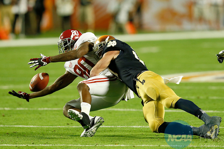 07 JAN 2013:  Zeke Motta (17) of the University of Notre Dame knocks the ball away from Marvin Shinn (80) of the University of Alabama during the Discover BCS National Championship game held at Sun Life Stadium in Miami Gardens, FL.  Jamie Schwaberow/NCAA Photos