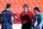 "16 October 2004: U.S. coach April Heinrichs (center) with Shannon Boxx (left) and Angela Hucles (right). The United States defeated Mexico 1-0 at Arrowhead Stadium in Kansas City, MO in an women's international friendly soccer game as part of the U.S.'s ""Fan Celebration Tour.""."