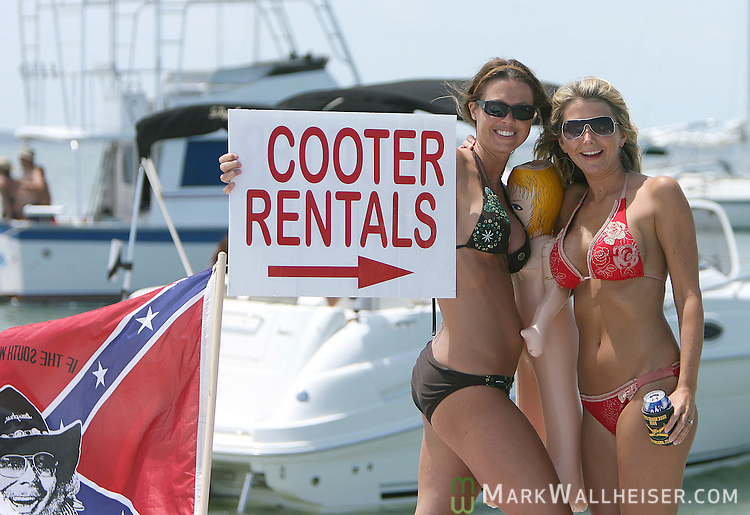 Two women celebrate the end of school and beginning of summer on Memorial Day weekend at the White Trash Bash at Dog Island off the coast of Carrabelle Sunday May 27, 2007.    (Mark Wallheiser/TallahasseeStock.com)