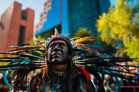 A Mexican girl, wearing a colorful feather headgear inspired by Aztecs, takes part in the Day of the Dead celebrations in Mexico City, Mexico, 29 October 2016. Day of the Dead (Día de Muertos), a syncretic religious holiday combining the death veneration rituals of the ancient Aztec culture with the Catholic practice, is celebrated throughout all Mexico. Based on the belief that the souls of the departed may come back to this world on that day, people gather at the gravesites in cemeteries praying, drinking and playing music, to joyfully remember friends or family members who have died and to support their souls on the spiritual journey.