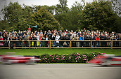 10th September 2017, Goodwood Estate, Chichester, England; Goodwood Revival Race Meeting; Goodwood spectators watch on as two race cars speed by