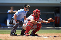 Greeneville Reds catcher Hunter Oliver (28) sets a target as home plate umpire Kyle Stutz looks on during the game against the Burlington Royals at Burlington Athletic Stadium on July 8, 2018 in Burlington, North Carolina. The Royals defeated the Reds 4-2.  (Brian Westerholt/Four Seam Images)