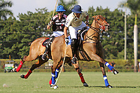WELLINGTON, FL - FEBRUARY 05:  Joaquin Panelo #2 of Valiente II controls the ball, as Nico Escobar #1 looks on during one of the early matches of the Ylvisaker Cup at the International Polo Club Palm Beach on February 05, 2017 in Wellington, Florida. (Photo by Liz Lamont/Eclipse Sportswire/Getty Images)