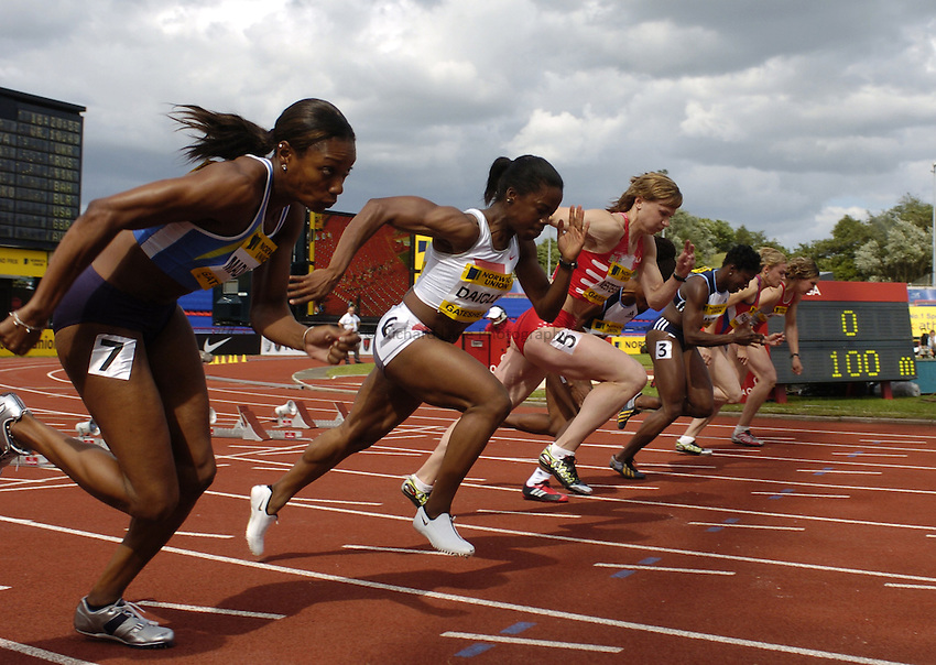 Photo. Jed Wee..Norwich Union British Grand Prix, 27/06/2004..Women's 100m athletes at the start.