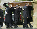 15/1/04          Copyright Pic : James Stewart.File Name : jspa16_doyle_funeral.LEE DOYLE (LEFT), SON OF IAIN, CARRIES THE COOFIN OF HIS MOTHER IRENE INTO THE CHURCH. IRENE DOYLE, THE WIFE OF110SPORT BOSS IAIN DOYLE, DIED WHILST IN SPAIN.... DOYLE'S 110SPORT LTD MANAGES SOME OF THE WORLD'S TOP SNOOKER STARS INCLUDING SCOTLAND'S STEPHEN HENDRY, WALES' MARK WILLIAMS AND IRELAND'S KEN DOHERTY....(see copy from George Mair / Tim Bugler).....Payment should be made to :-.James Stewart Photo Agency, 19 Carronlea Drive, Falkirk. FK2 8DN      Vat Reg No. 607 6932 25.Office     : +44 (0)1324 570906     .Mobile  : +44 (0)7721 416997.Fax         :  +44 (0)1324 570906.E-mail  :  jim@jspa.co.uk.If you require further information then contact Jim Stewart on any of the numbers above.........