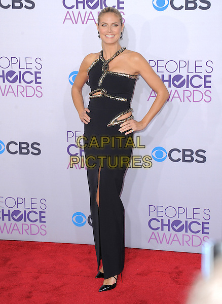 Heidi Klum.The 2013 People's Choice Awards held at Nokia Live in Los Angeles, California 9th January 2013                                                                   .full length dress black silver gold trim cut out away hands on hips slit split .CAP/DVS.©DVS/Capital Pictures.